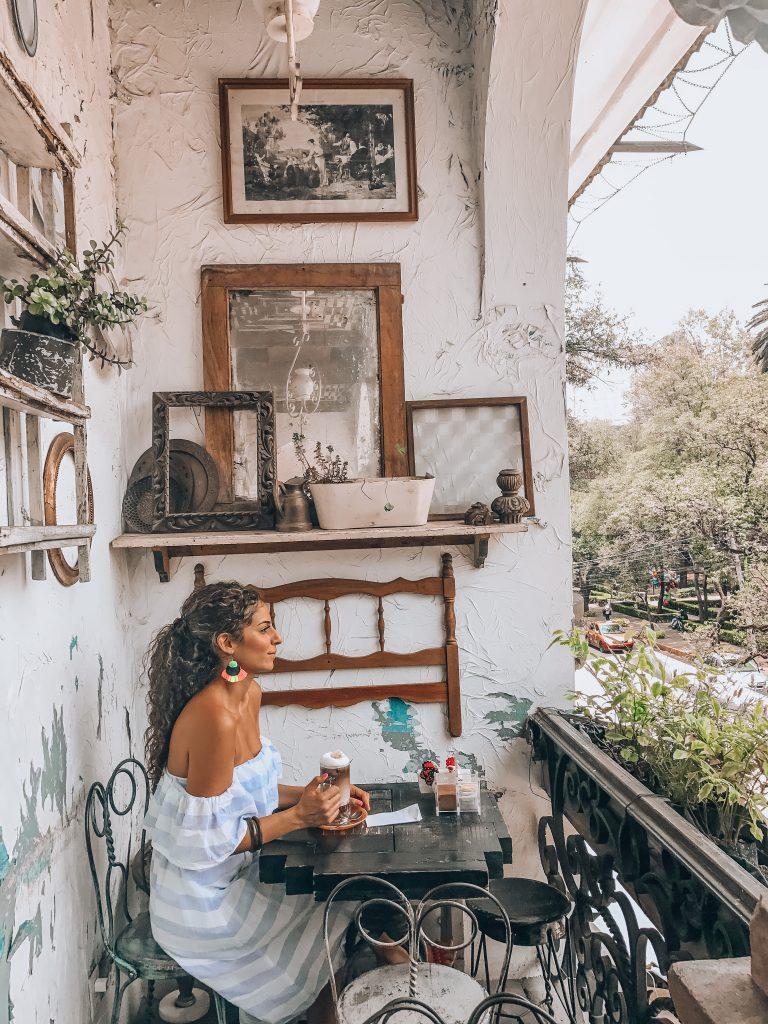 Girl having coffee outdoors