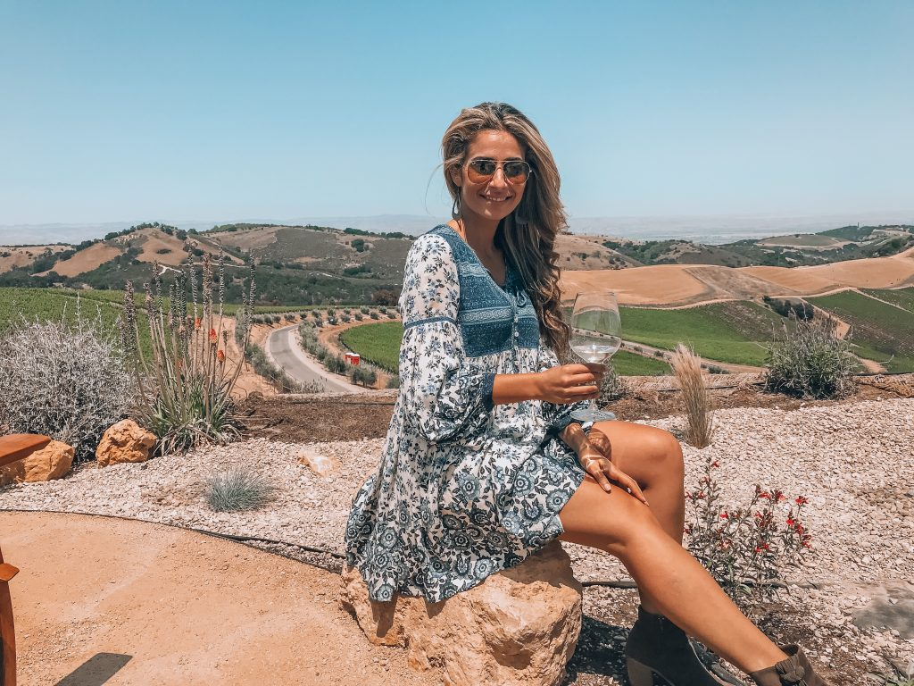 Sitting on a rock wine tasting at DAOU Vineyards in Paso Robles
