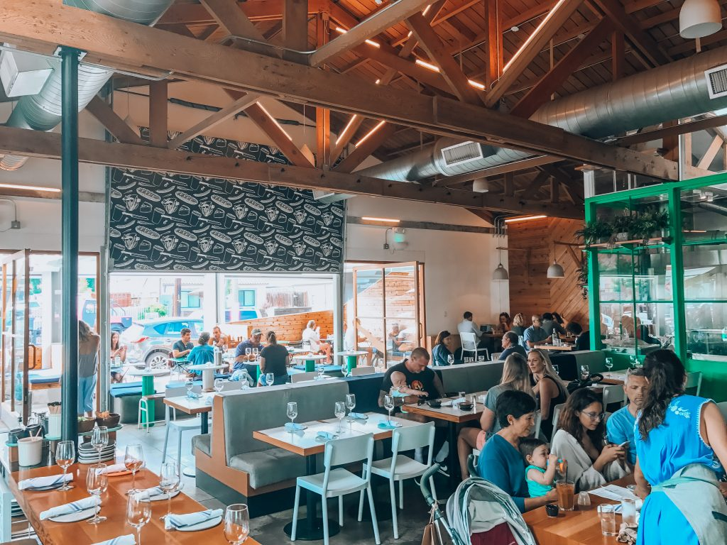 Indoor and outdoor open seating for brunch at Superba in Venice.